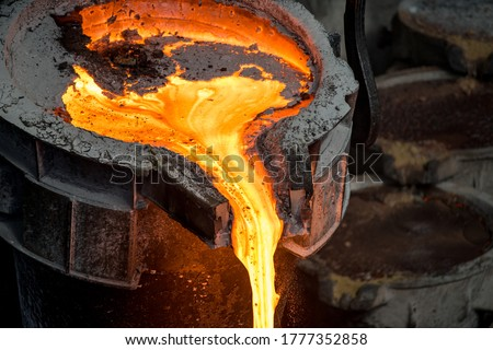 Tank pours liquid metal at the steel mill Royalty-Free Stock Photo #1777352858