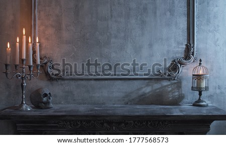Mystical Halloween still-life background. Skull, candlestick with candles, old fireplace. Horror and witchery. #1777568573