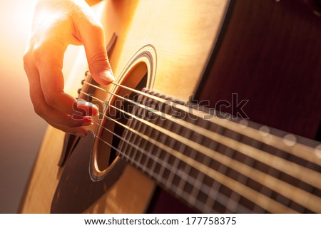woman's hands playing acoustic guitar, close up #177758375
