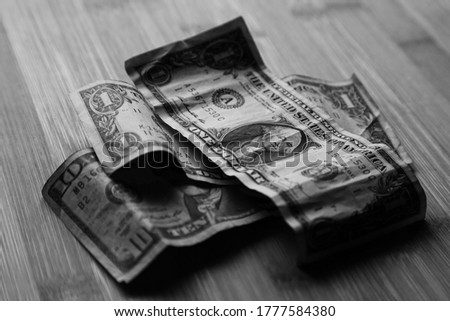 American banknotes (money) on a wooden table.