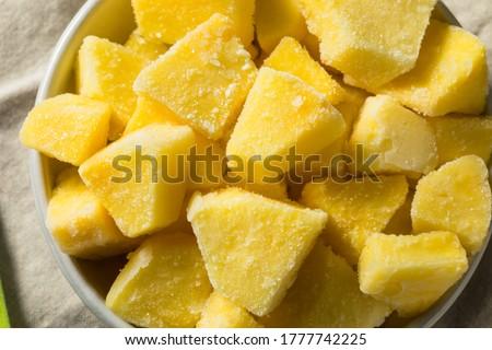 Yellow Organic Frozen Pineapple Slices to Eat Royalty-Free Stock Photo #1777742225