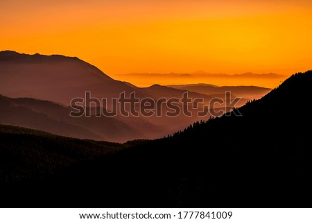 Sunset  over mountains landscape. Orange sunset in mountains. Mountain sunset hills. Mountain sunset landscape #1777841009