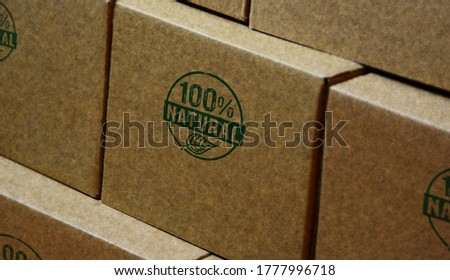100 percent natural stamp printed on cardboard box. Ecology, bio food, organic and healthy diet concept.