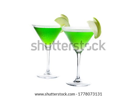 Green appletini cocktail in glass isolated on white background.  #1778073131