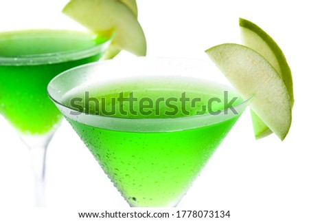 Green appletini cocktail in glass isolated on white background.  #1778073134
