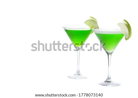 Green appletini cocktail in glass isolated on white background. Copy space #1778073140