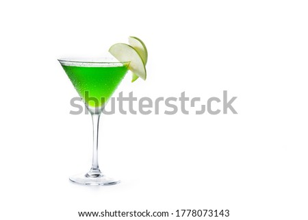 Green appletini cocktail in glass isolated on white background. Copy space #1778073143