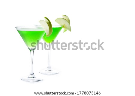Green appletini cocktail in glass isolated on white background. Copy space #1778073146