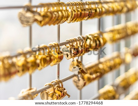 Fence that locks golden love padlocks that promises the love of the couples lovers which vowed their love.