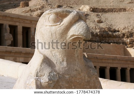Funeral temple of Hatshepsut in Deir El-Bahri and ancient god Ra and RA at the entrance to the temple in Egypt #1778474378