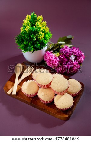 Ancient egg cakes in paper cup with purple background - stock photo #1778481866