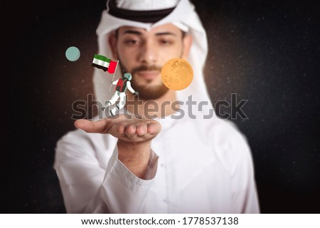 Emirati young man holding an astronaut in the space with UAE flag floating with Mars, United Arab of Emirates to the space. Royalty-Free Stock Photo #1778537138