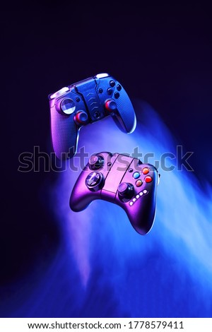 Levitation of two controller joysticks. Concept of gaming and entertainment. Royalty-Free Stock Photo #1778579411