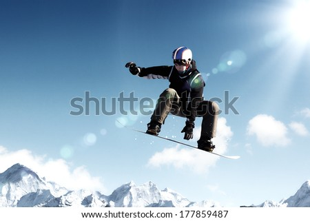 Snowboarder making jump high in clear sky #177859487