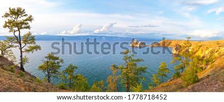 Beautiful landscape of Siberian Baikal Lake. Panoramic view of Khuzhir Bay and Shamanka Rock on Olkhon Island at sunset. Natural background #1778718452