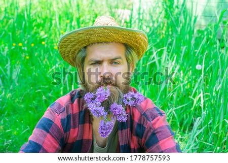 Flowers in my beard. Portrait of handsome bearded man with flowers in his beard. Handsome man with beard of flowers. Bearded man with decorated beard. #1778757593