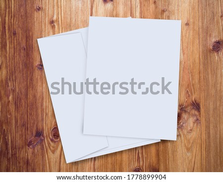 Wooden background with envelope and white page for your design, mock up