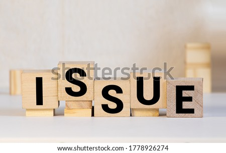 Issue word on wooden cubes. Issue concept Royalty-Free Stock Photo #1778926274