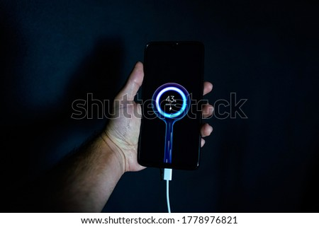 holding charging smartphone quick charge fast charge