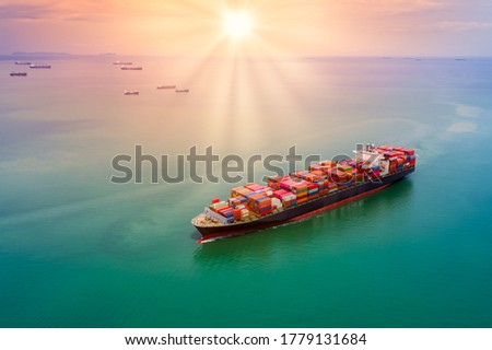 container cargo logistics shipping import export business service transportation of international by container cargo freight shipping open sea and the sunset over colourful process background Royalty-Free Stock Photo #1779131684