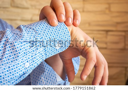 Person - patient shows localization of pain, numbness, paralysis or inability to move hand in wrist. Concept photo of arm fracture, tunnel syndrome, nerve damage and other symptoms from upper limb