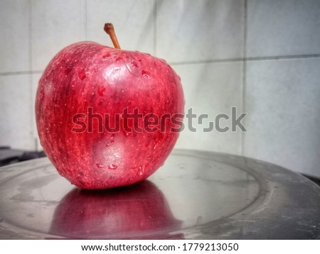 This Picture Contains a delicious Red Apple.
