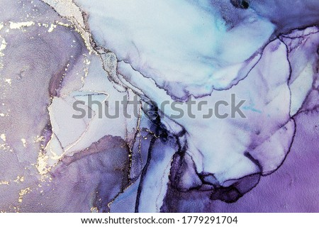 Luxury abstract fluid art painting background alcohol ink technique purple and gold. Modern contemporary art. Part of original alcohol ink painting. Hand painted ink texture. Card Background Royalty-Free Stock Photo #1779291704