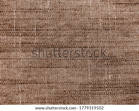 Brown denim jeans fabric texture background. Detail of old brown jeans denim texture background. Texture of denim vintage background. Textile jeans brown western fabric rough material. Pants old jean #1779319502