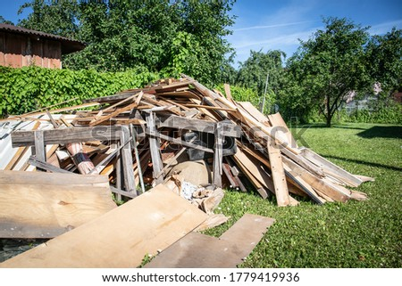 Wooden debris at the yard, boards and plates. Construction and reconstruction concept. Royalty-Free Stock Photo #1779419936