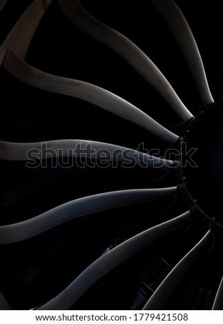 Turbine blades of an aircraft jet engine. Close up Turbines Engine. Aviation Technologies. Aircraft jet black detail during maintenance. Background. Macro. Royalty-Free Stock Photo #1779421508
