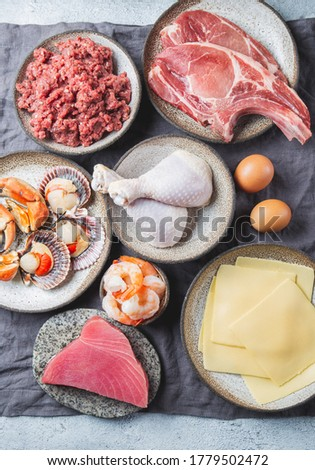 Animal protein sources background with copy space. Carnivore diet concept. Meat, cheese, fish, eggs and seafood. Royalty-Free Stock Photo #1779502472