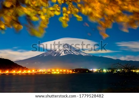 Japan. Evening lights of the city at the foot of mount Fuji. Five lakes of Fuji. The town of Fujikawaguchiko on the lake. Autumn landscape of Japan. The mountain is a symbol of Japan. #1779528482