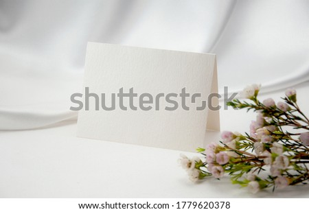 Mockup blank card, for Name place, Folded, greeting, invitation with wax flower on white background. Royalty-Free Stock Photo #1779620378
