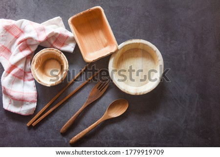 Eco friendly disposable tableware from palm leaf or betel nut , zero waste environment concept / Natural eco-friendly food packaging disposable utensils with dish plate bowl cup and wooden fork spoon  #1779919709