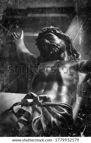 The crucifixion of Jesus Christ. Retro styled image of an ancient statue.
