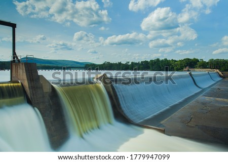 Hydroelectric power energy plant with turbines and water spills for generating green electricity. Free, green adn ecological energy concept. Climate changes Royalty-Free Stock Photo #1779947099
