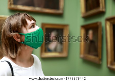 Portrait of woman wearing protection mask in museum Royalty-Free Stock Photo #1779979442