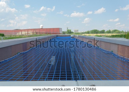 Stretched mesh to prevent falling down. Safety net between houses. Royalty-Free Stock Photo #1780130486