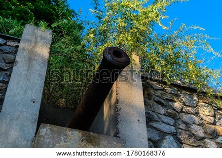 The weapon port and old cannon in the fortress. #1780168376