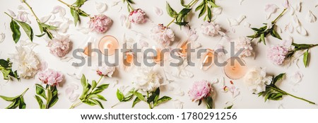 Rose wine variety layout. Flat-lay of rose wine in glasses with peony flowers over white background, top view. Summer drink for party, wine shop or wine tasting concept #1780291256