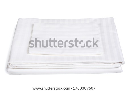 Home textile. A set of bed linen in stripes. A sheet, duvet cover, and pillowcase. Change of linens. Linen fabric. Royalty-Free Stock Photo #1780309607