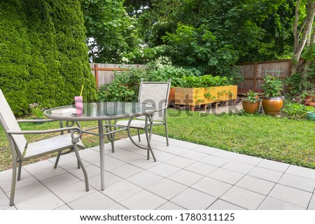 Backyard Patio Garden with Patio Furniture and Raised Garden Beds