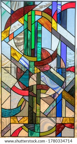 Stained Glass Window Panel of Yin and Yang Circles Royalty-Free Stock Photo #1780334714