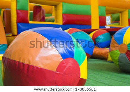 Colored balls and toys in a children play center #178035581
