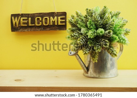 Welcome sign Hanging on yellow background