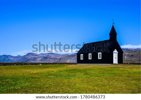 Black church in mountain valley. Iceland black church. Black church #1780486373