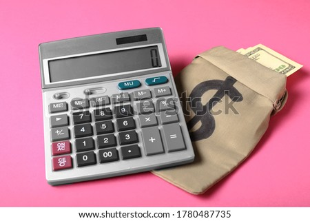 Calculator with money in bag on color background #1780487735