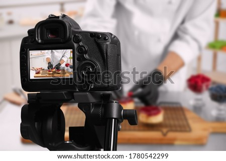 Food photography. Shooting of chef decorating dessert, focus on camera