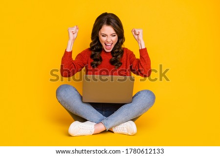 Full size photo of crazy ecstatic woman sit floor legs crossed work remote win contract wear red sweater jumper denim jeans shoes isolated over bright shine color background Royalty-Free Stock Photo #1780612133