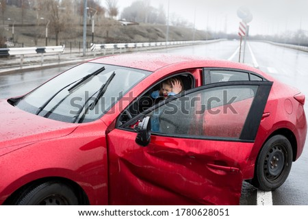 Young pretty scared woman in the car. Injured woman feeling bad after having a car crash Royalty-Free Stock Photo #1780628051